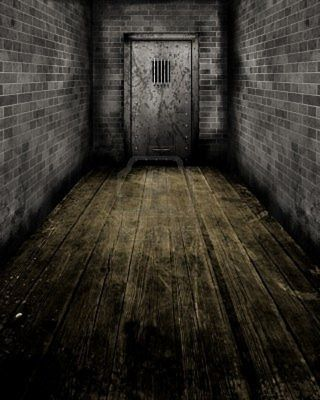 10965236-grunge-style-image-of-passageway-leading-to-an-old-prison-door
